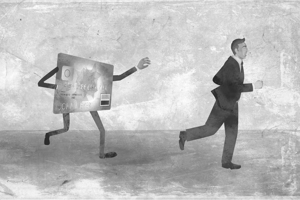 Exhausted businessman running away from credit card