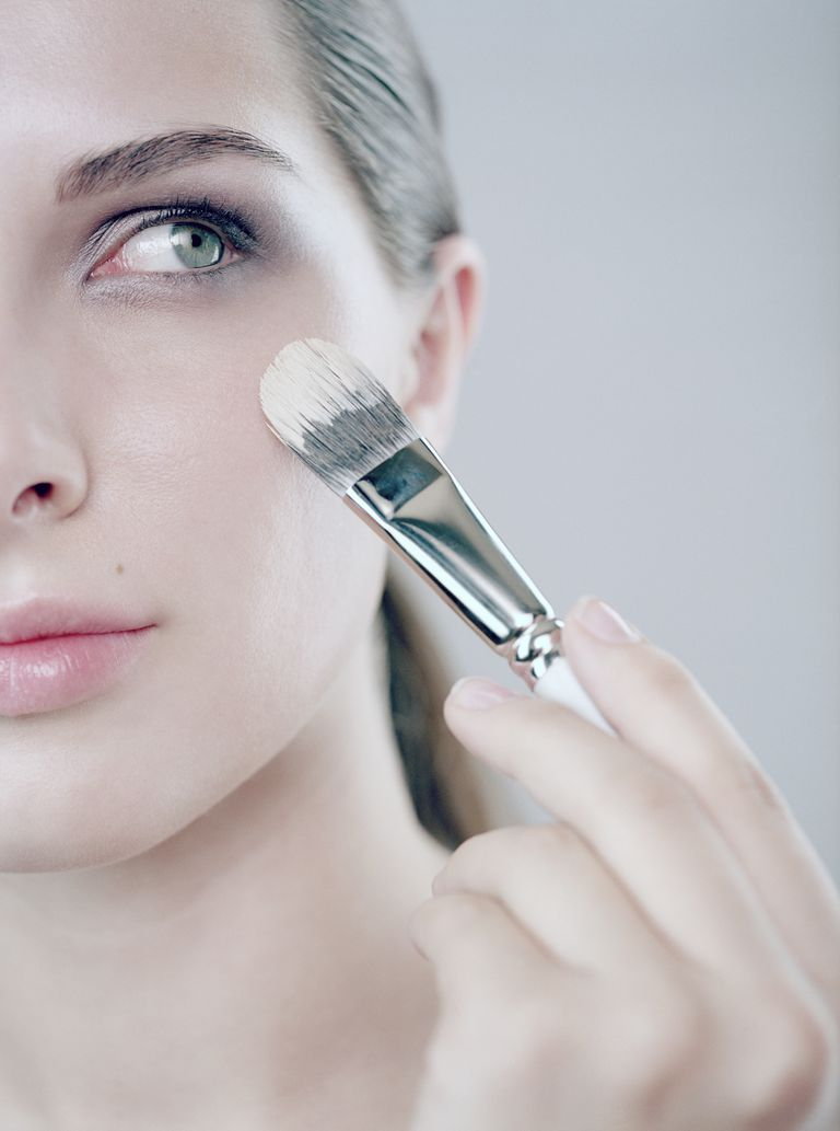 Woman putting on foundation