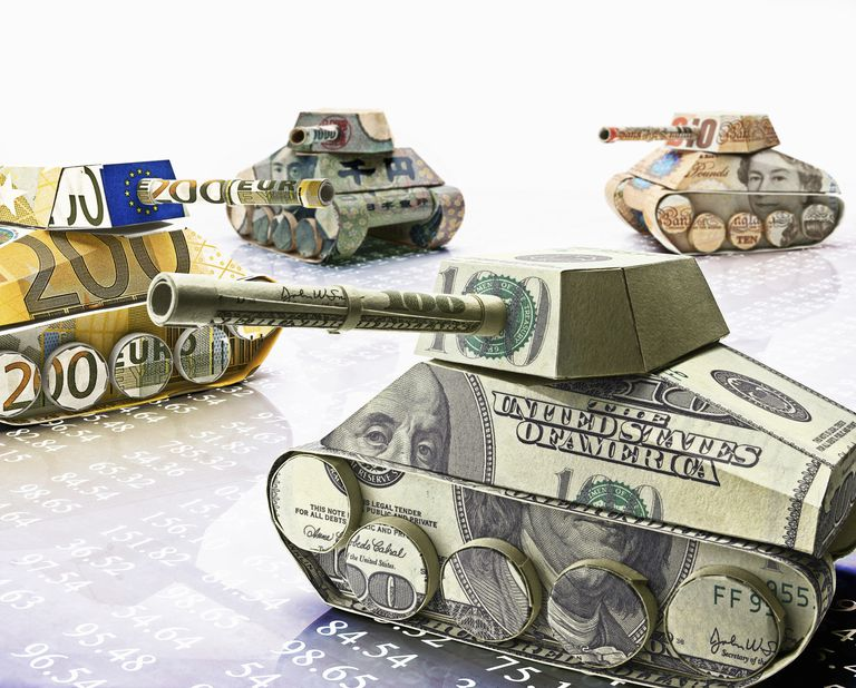 Military tanks formed from yen, dollar, euro and British pound banknotes