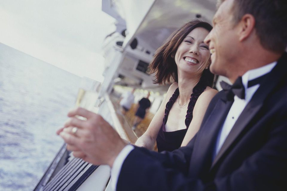 Couple with champagne on cruise ship deck
