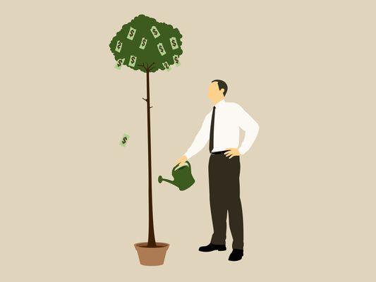 Man watering money tree