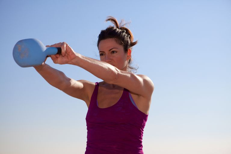 Woman swinging kettlebell