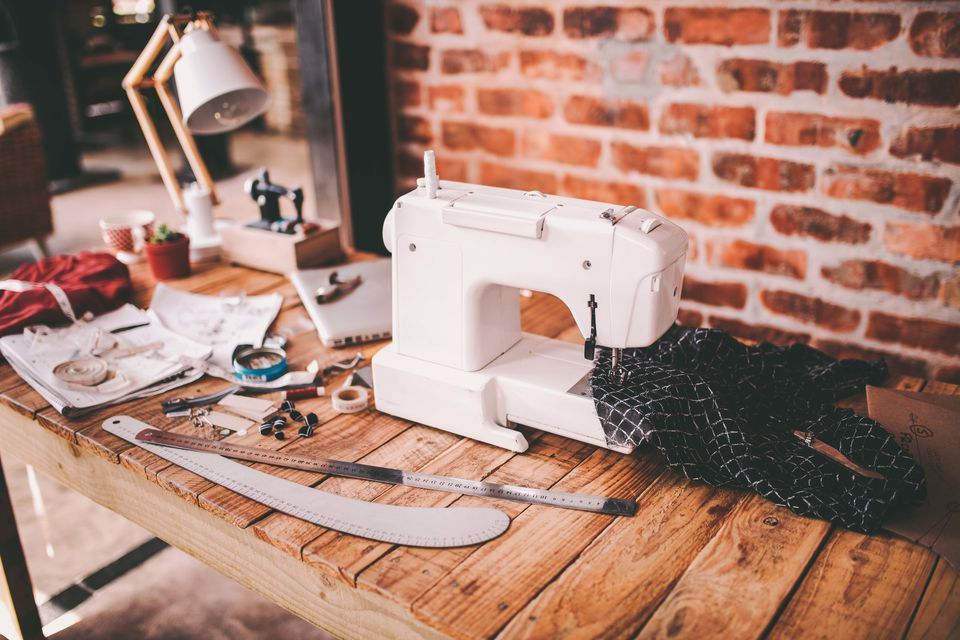 Desk with sewing machine and tools