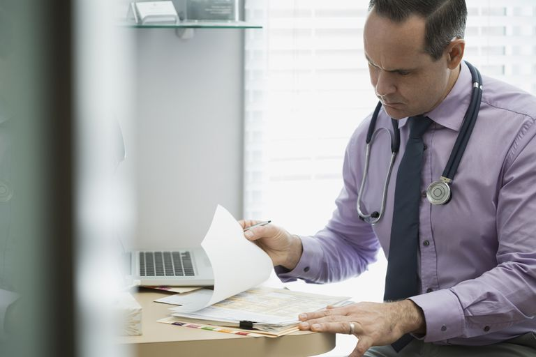 Doctor checking a medical record