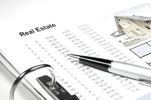 Listing of rental real estate properties and deductions.