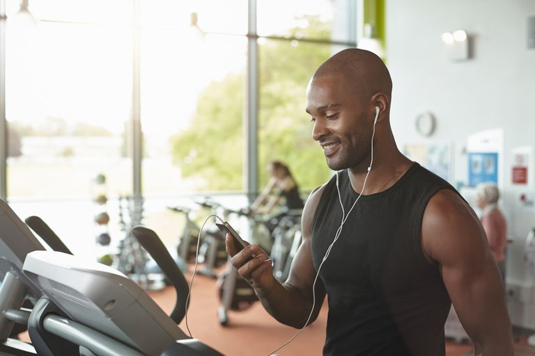 Man on Treadmill with Smartphone