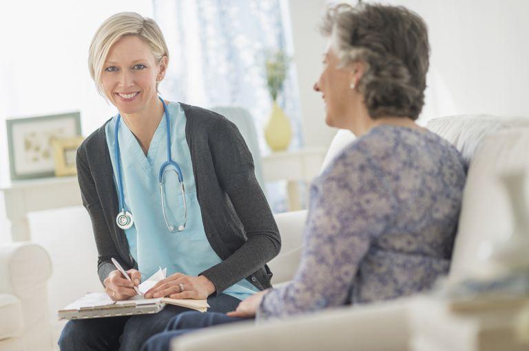 Nurse Visiting Patient At Home