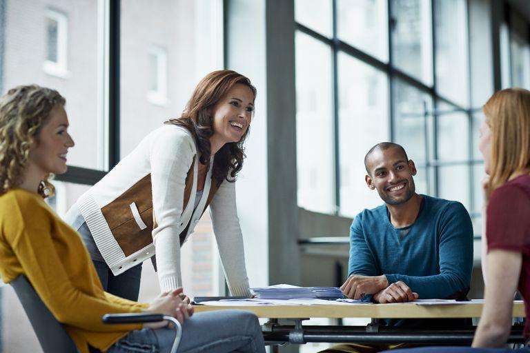 Smiling coworkers in meeting