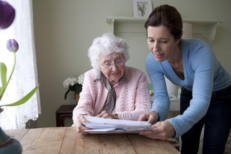 Caregiver and Senior Reading Together