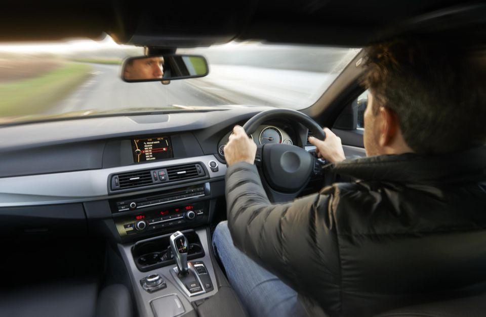 Man driving right-hand-drive car