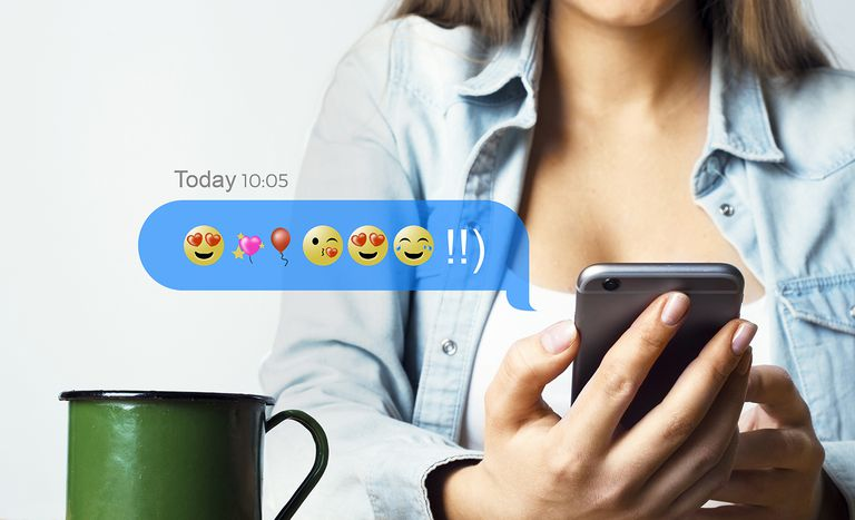 Woman texting with emojis