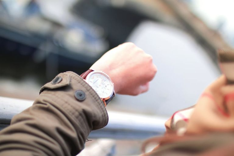 woman looking at wristwatch