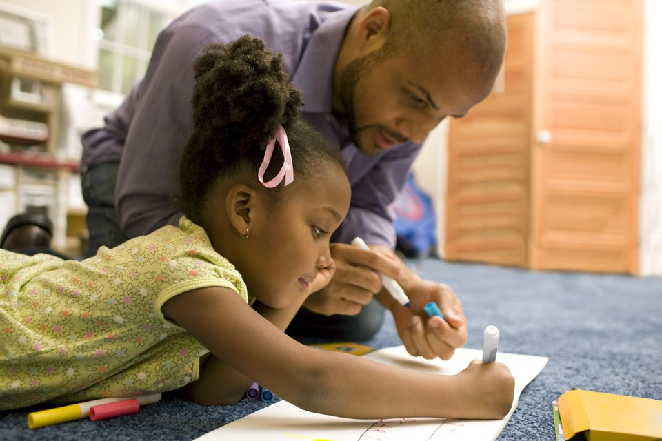 Father coloring with his daughter