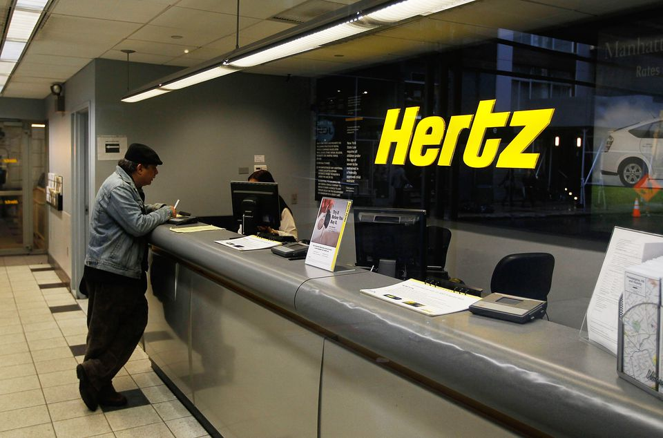 A customer talks with a Hertz car rental agent.