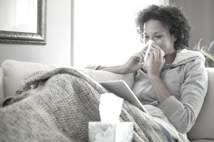 woman nurding a cold at home