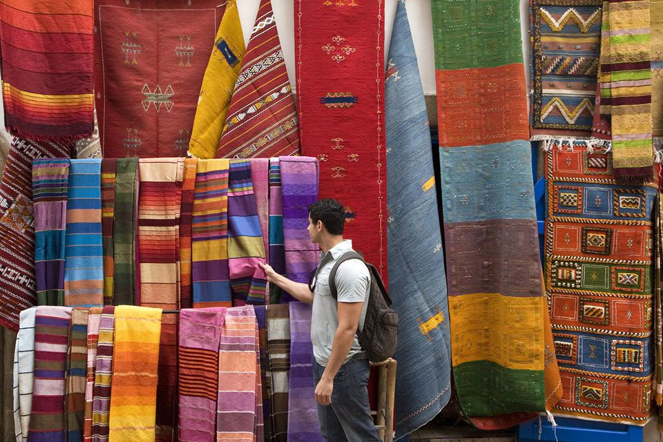 Tourist at fabrics and rugs shop in Essaouira