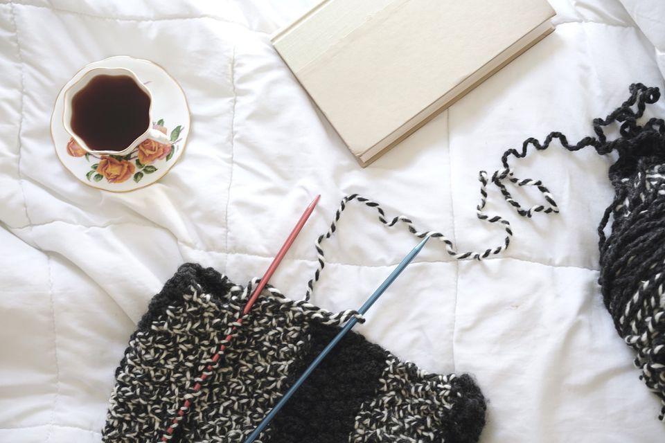 Knitting blanket on bed