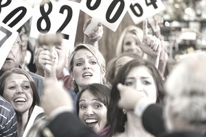 A photo of people at an auction.
