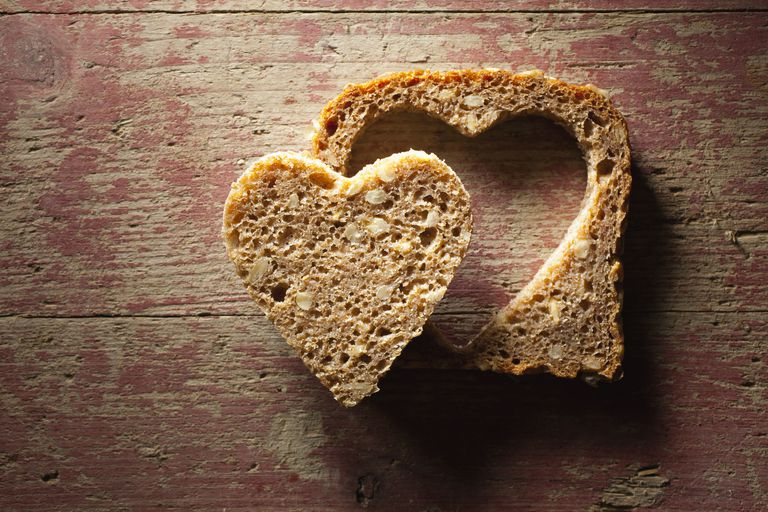 Directly above shot of bread with heart shape on table