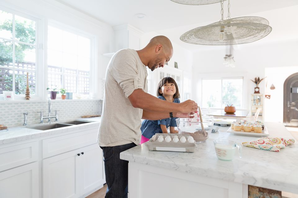 Father and daughter baking in the kitchen