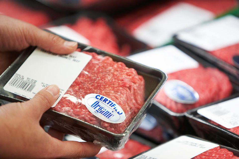 Man holding package of ground beef