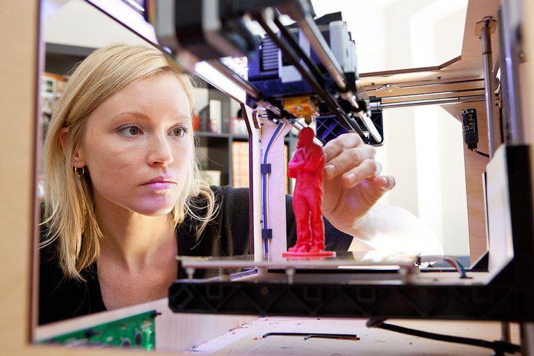 Woman using 3D printer