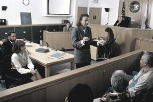 Female lawyer speaking to jury in courtroom