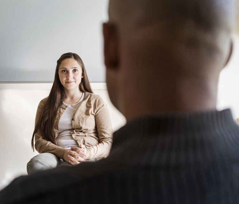 man and woman conducting interview