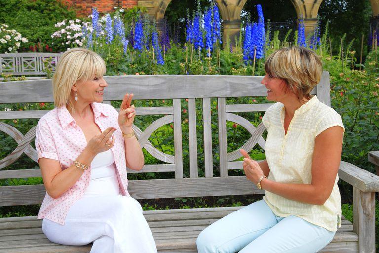 Women communicating in sign language