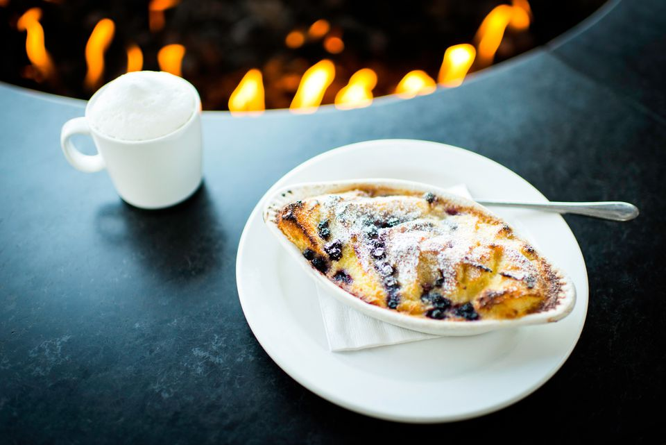 Pudding and coffee by restaurant open fire