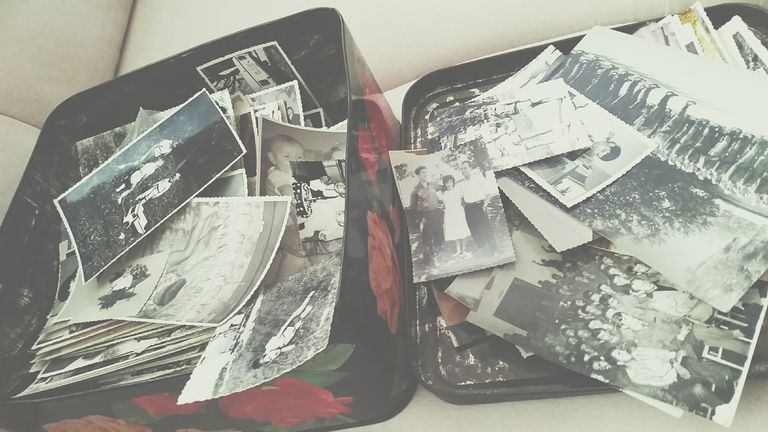 High Angle View Of Old Photographs In Box