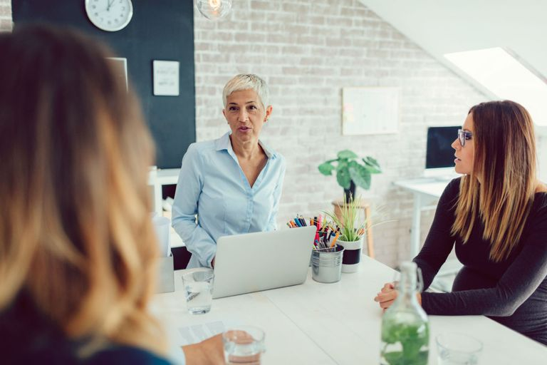 Three businesswomen conducting a meeting in a casual office