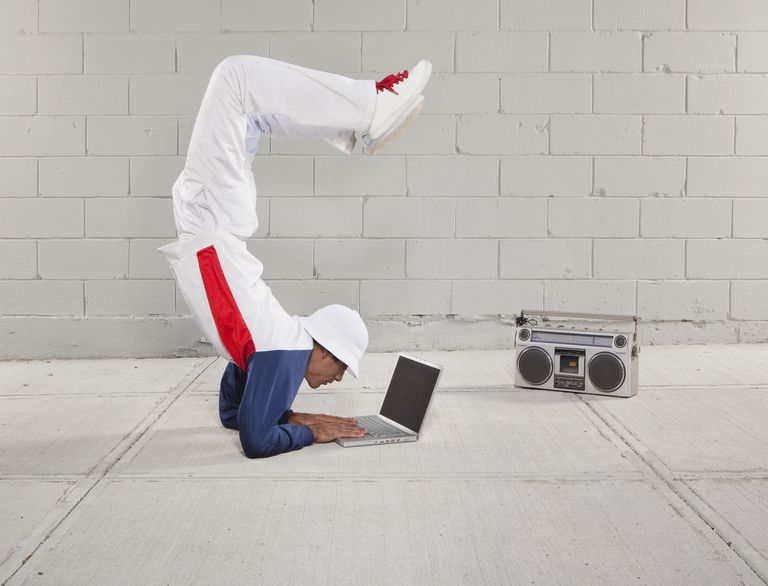 Man breakdancing with laptop