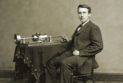 Photograph of Thomas Edison with an early phonograph.