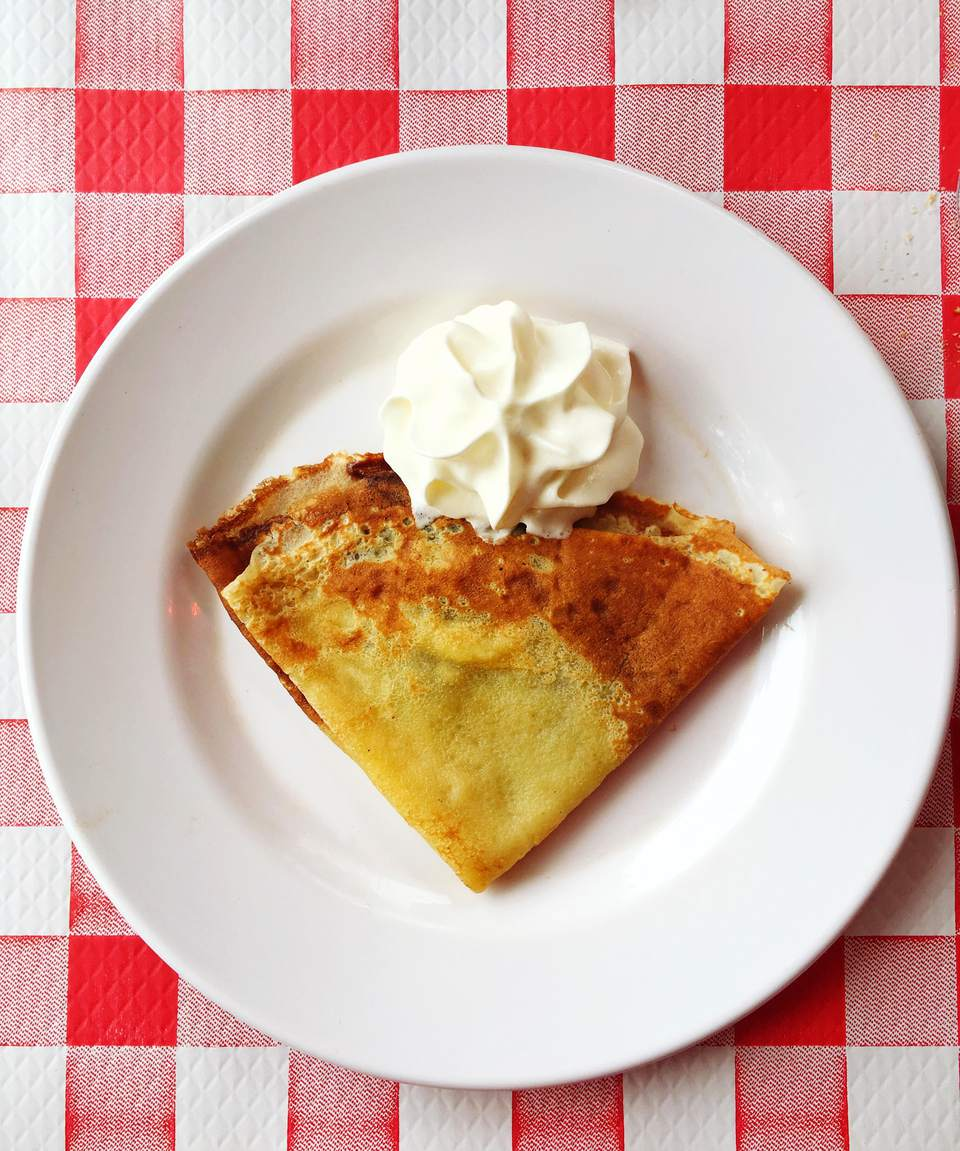 High Angle View Of Crepe And Whipped Cream In Plate On Table