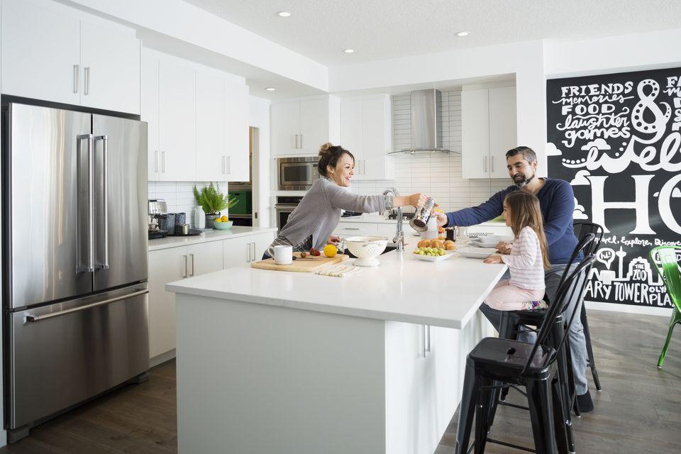 Family enjoying breakfast in morning kitchen