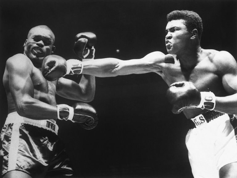 Boxer Cassius Clay Punching Doug Jones