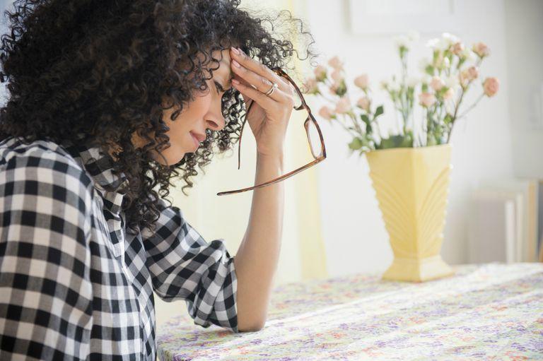 Woman has migraine