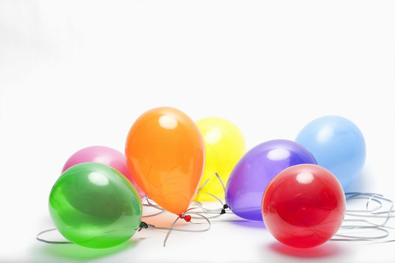 Carbon dioxide is heavier than air, so dry ice balloons will rest on a surface rather than float.
