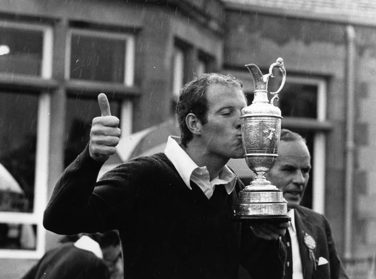 Tom Weiskopf, winner of the 1973 British Open, kisses the Claret Jug
