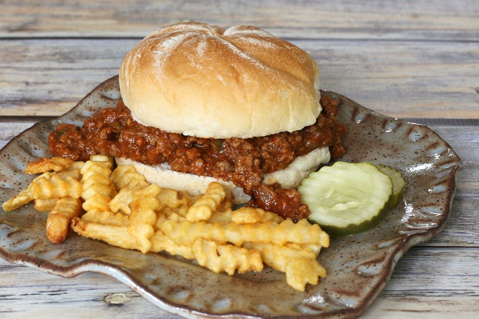 sloppy joe with barbecue sauce and some sausage