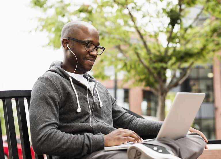 Student writing on laptop