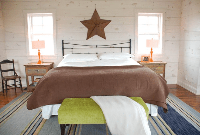 Country bedroom with star on wall.
