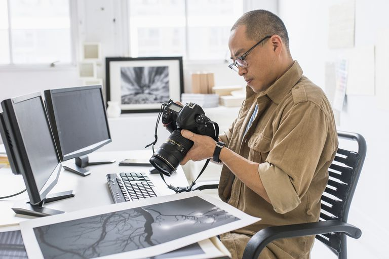 A photographer looks at his photos.