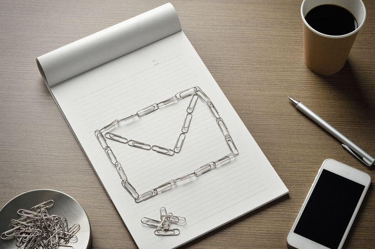 Notepad with paperclips forming a envelope on it