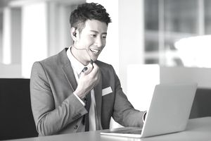 business man on phone with laptop