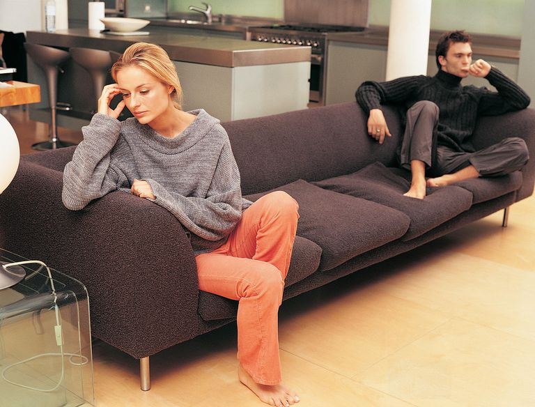 Upset Couple Sitting on a Sofa