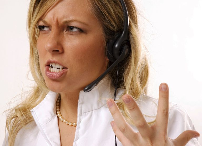 182147522 An attractive female phone representative ready to strangle the customer.