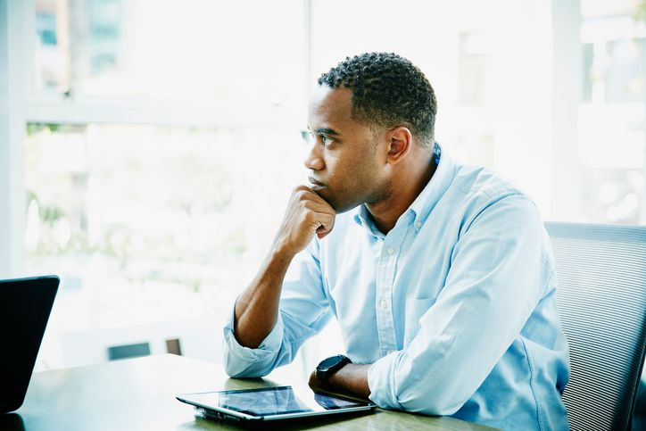 businessman sitting in front of laptop in modern office