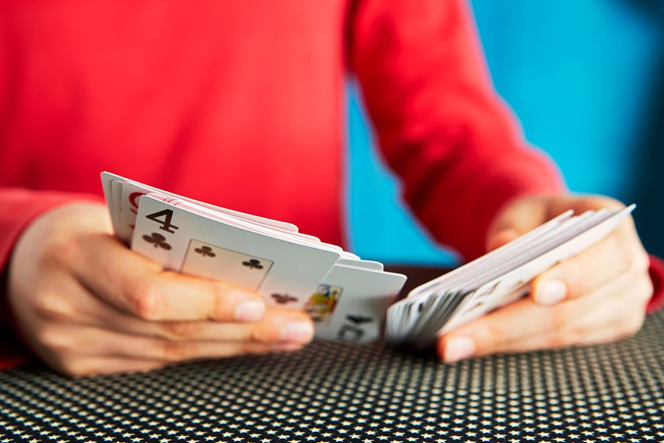 Child shuffling cards, card trick